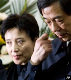 FILE - Gu Kailai, left, and husband Bo Xilai, shown in 2007, now are in prison.