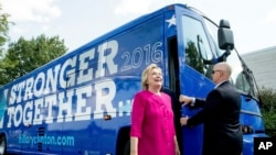 FILE - Democratic presidential candidate Hillary Clinton gets off her campaign bus as she arrives for a rally at K'NEX, a toy company in Hatfield, Pa., July 29, 2016.
