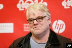 "Cast member Philip Seymour Hoffman poses at the premiere of the film ""A Most Wanted Man"" during the 2014 Sundance Film Festival in Park City, Utah, Jan. 19, 2014."