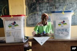 A election official writes as people cast their ballots during elections in Bangui, Central African Republic, Dec. 30, 2015.