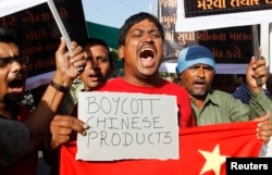 Traders protest against China in the western Indian city of Ahmedabad on May 3, 2013. They were demanding the withdrawal of Chinese soldiers who set up camp in a remote territory in the Himalayas that is claimed by India.