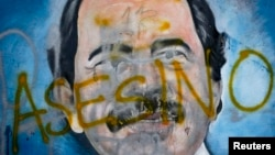 "The Spanish word for ""murderer"" covers a mural of Nicaragua's President Daniel Ortega, May 26, 2018, as part of anti-government protests demanding his resignation in Managua, Nicaragua."