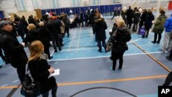 People line up to cast their vote Dec. 3. 2015 in a polling station at a public School in Copenhagen.
