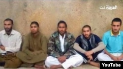 FILE - Iranian border guards purportedly captured by the Pakistani group Jaish al-Adl.