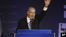 Israel's Prime Minister Benjamin Netanyahu greets his supporters in Tel Aviv, Israel, Jan. 23, 2013