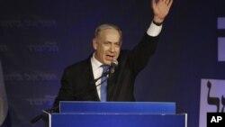 Israel's Prime Minister Benjamin Netanyahu greets his supporters in Tel Aviv, Israel, Jan. 23, 2013