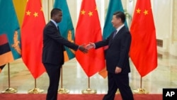 FILE - Zambia's President Edgar Lungu, left, shakes hands with China's President Xi Jinping, prior to their bilateral meeting at the Great Hall of the People, in Beijing, China, Sept. 1, 2018. Some are expressing concerns that Beijing is pursuing debt-trap diplomacy vis-a-vis African countries.