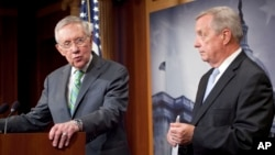 Senate Minority Leader Harry Reid of Nevada, left, and Senate Minority Whip Richard Durbin of Illinois answer questions for reporters following the Senate vote on the Iran nuclear agreement on Capitol Hill in Washington, Sept. 10, 2015.
