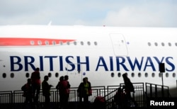 FILE - British Airways' new Airbus A380 arrives at a hanger after landing at Heathrow airport in London July 4, 2013.