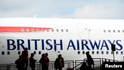 FILE - A British Airways jet arrives at a hanger after landing at Heathrow airport in London July 4, 2013.