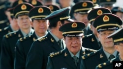 FILE - Chinese military officers arrive outside the Great Hall of the People in Beijing.