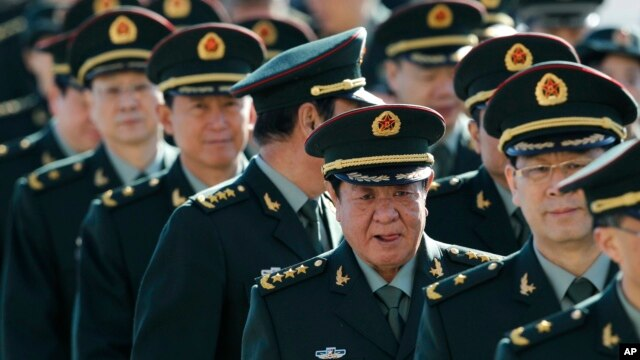 Chinese military officers are shown the way as they arrive outside the Great Hall of the People in Beijing, March 4, 2013.
