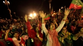 Supporters of Pakistani cricketer-turned-politician, Imran Khan, cheer while listening to him speak in Islamabad August 20, 2014.