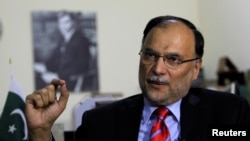 FILE - Ahsan Iqbal, Pakistan's interior minister, speaks with Reuters in Islamabad, June 12, 2017.
