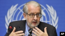 Chairperson of the Commission of Inquiry on Syria, Professor Paulo Pinheiro gestures during a press conference ahead of his mission on at the United Nations office in Geneva, September 30, 2011.