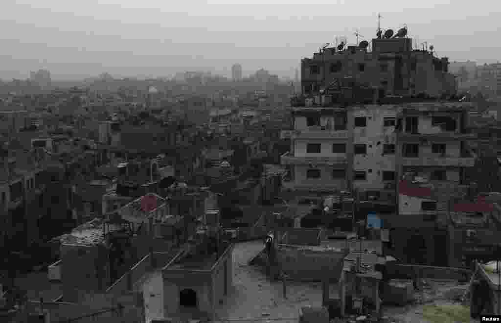 A general view of damaged buildings are seen in the besieged area of Homs, March 3, 2014.