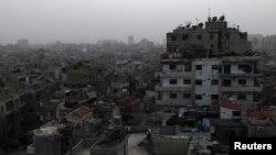 Homs, que l'armée syrienne tente de reprendre aux rebelles