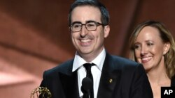 "John Oliver and the crew of ""Last Week Tonight with John Oliver"" accept the award for outstanding variety talk series at the 68th Emmy Awards, Sept. 18, 2016, in Los Angeles."