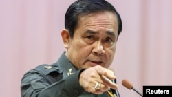 "FILE - Thailand's Prime Minister Prayuth Chan-ocha gestures as he speaks during an event titled ""The Instruction on the Procedures of Members of the National Reform Council"" at the Army Club in Bangkok, September 4, 2014."