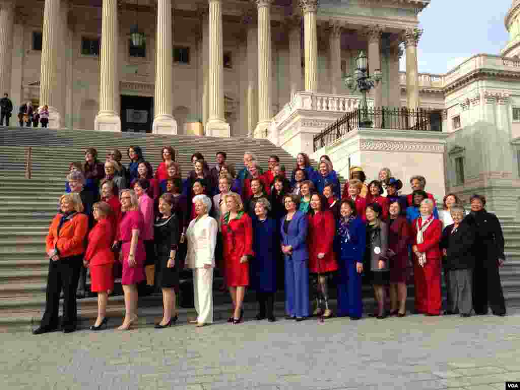 Women members of Congress gather in front of the Capitol, Washington, January 3, 2013.