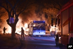 Firefighters work at a scene of fire from an explosion in Ankara, Feb. 17, 2016.