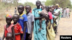 FILE - Residents displaced due to the recent fighting between government and rebel forces in the Upper Nile capital Malakal wait at a World Food Program (WFP) outpost.