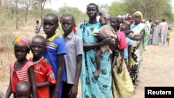 FILE - Residents displaced due to the recent fighting between government and rebel forces in the Upper Nile capital Malakal wait at a World Food Program (WFP) outpost where thousands have taken shelter in Kuernyang Payam, South Sudan, May 2, 2015.