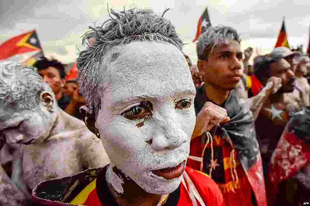 Fretilin party supporters participate in an election campaign rally in Dili, East Timor.