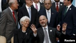 European Economic and Financial Affairs Commissioner Pierre Moscovici and International Monetary Fund Managing Director Christine Lagarde speak as they wait for a group photo of the G-20 finance ministers and central bank governors in Ankara, Turkey, Sept