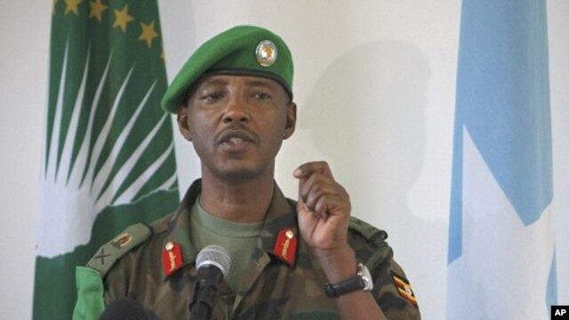 Current African Union Mission in Somalia (AMISOM) Force Commander Major General Fred Mugisha, speaks to the Somali media at the mission's headquarters in the capital Mogadishu in this handout photo taken April 26, 2012.
