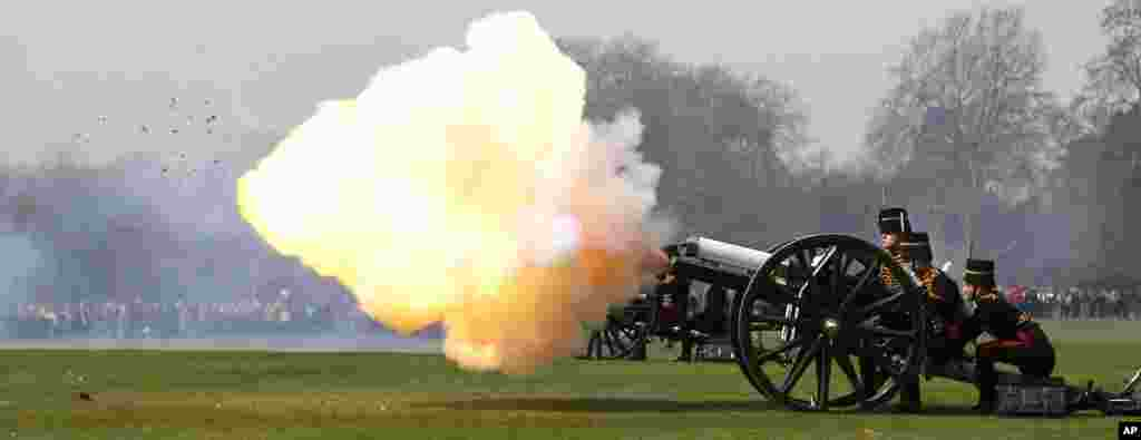 The King's Troop Royal Horse Artillery fire a 41-gun Royal Salute in Hyde Park, in London. The salute marks the 90's birthday of Britain's Queen Elizabeth II.