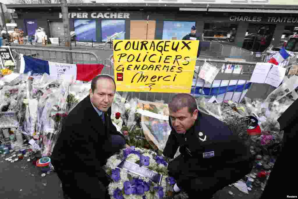 Jerusalem Mayor Nir Barkat and Jerusalem District Commander, Major General Moshe Chico Edry place flowers near the Hyper Cacher kosher supermarket at the Porte de Vincennes in Paris, Jan. 21, 2015.