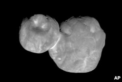"""FILE - This Tuesday, Jan. 1, 2019 image made available by NASA shows the Kuiper belt object originally called """"Ultima Thule,"""" about one billion miles beyond Pluto. Photo taken by the New Horizons spacecraft."""