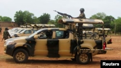 FILE - A Nigerian soldier is seen operating a weapon atop a truck.