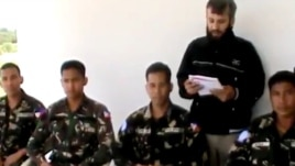 In this image taken from video obtained from the Ugarit News, which has been authenticated based on its contents and other AP reporting, four abducted Filipino UN peacekeepers are seen in Daraa, Syria, May 9, 2013.