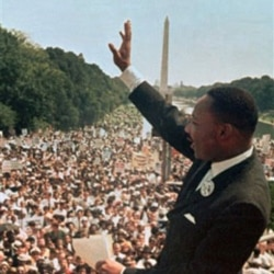 "Dr. Martin Luther King Jr. waves to the crowd at the Lincoln Memorial for his ""I Have a Dream"" speech on August 28, 1963"