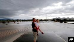 Des rues inondées à Phoenix dans l'Arizona (AP)