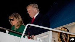 President Trump and first lady Melania Trump arrive at Andrews Air Force Base, Md., Dec. 27, 2018, after traveling to Iraq and Germany.