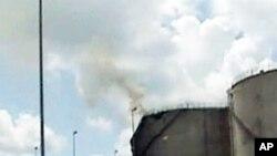 Burning oil tanks in Libya
