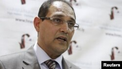 Nuri al-Abbar, chairman of the Libyan electoral commission, holds a news conference in Tripoli, June 10, 2012.
