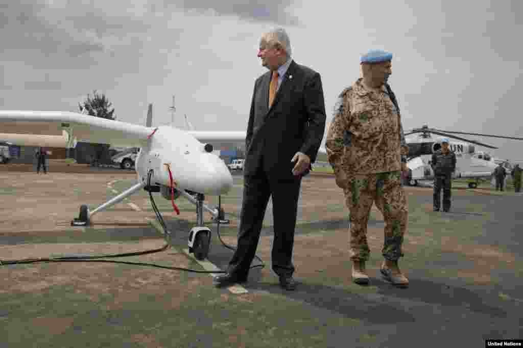 Under-Secretary-General Hervé Ladsous is given a briefing on the drones during the official launch in Goma, DRC, Dec. 3, 2013.