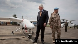 Undersecretary-General Hervé Ladsous is given briefing on drones during their official launch in Goma, Dec. 3, 2013.