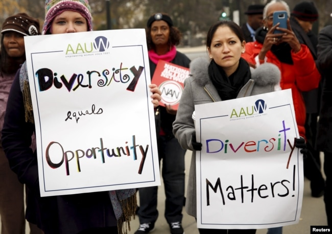 FILE – Demonstrators take part in a rally as the US Supreme Court hears the affirmative action in university admissions case in Washington, Dec. 9, 2015. The partnership behind 'The Challenge of Diversity' hopes to inspire game designers and filmmakers to