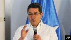 The President of Honduras, Juan Orlando Hernandez, announces his intention to run for another term, in Tegucigalpa, Nov. 9, 2016.