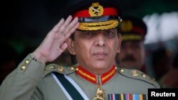 Pakistani Army Chief General Ashfaq Kayani salutes while reviewing the passing out parade of newly recruited soldiers during a ceremony in Quetta, October 11, 2011 file photo.