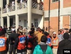 Emergency responders on scene of attack at Bacha Khan University in Charsadda, Pakistan, Jan. 20, 2016. (Photo: N. Takar / VOA Deewa)