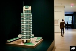 "A 1952 model of architect Frank Lloyd Wright's Price Tower hi-rise, which was built in Bartlesville, Okla., is displayed at the press preview for the MOMA exhibition, ""Frank Lloyd Wright at 150: Unpacking the Archive,"" June 8, 2017, in New York."