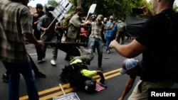 A man hits the pavement during a clash between members of white nationalist protesters against a group of counterprotesters in Charlottesville, Va,, Aug. 12, 2017. (REUTERS/Joshua Roberts)