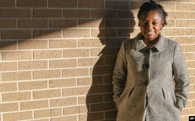 FILE - Joycelyn Davis, a direct descendant of Clotilda survivor Charlie Lewis, stands for a portrait at the community center in Africatown in Mobile, Ala., Jan. 29, 2019.