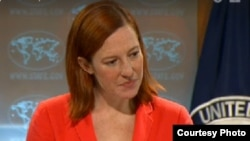 FILE - Then-State Department spokesman Jen Psaki is seen in a State Department video. Excerpts from an earlier briefing video were deliberately removed, leading to a new policy for how video and transcripts are handled.